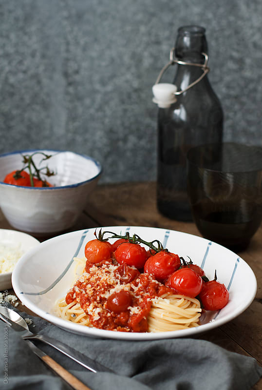 Spaghetti with cherry tomatoes and Parmesan cheese by Dobránska Renáta for Stocksy United