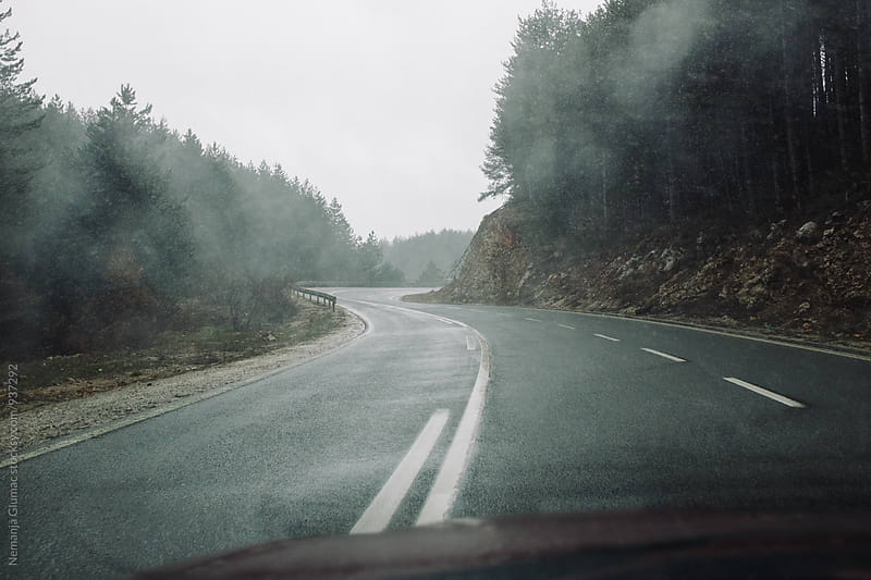 View From a Car Driving on a Wet Road  by Nemanja Glumac for Stocksy United