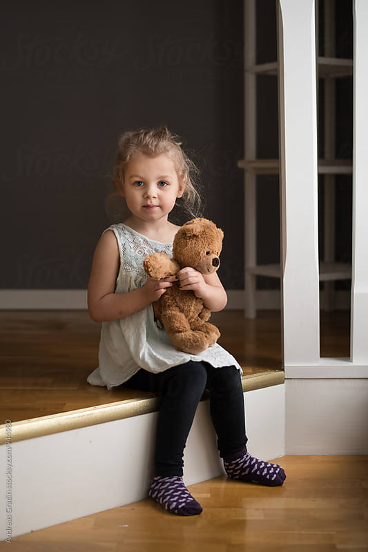 girl and teddy bear by Andreas Gradin for Stocksy United