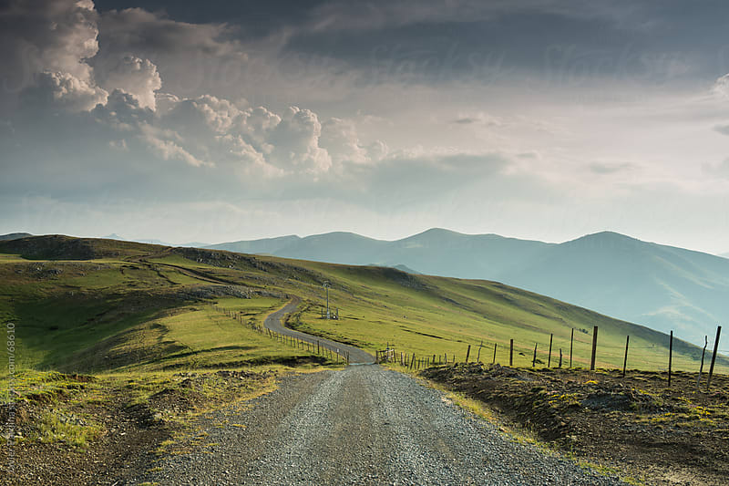 rural road through the meadows by Javier Pardina for Stocksy United