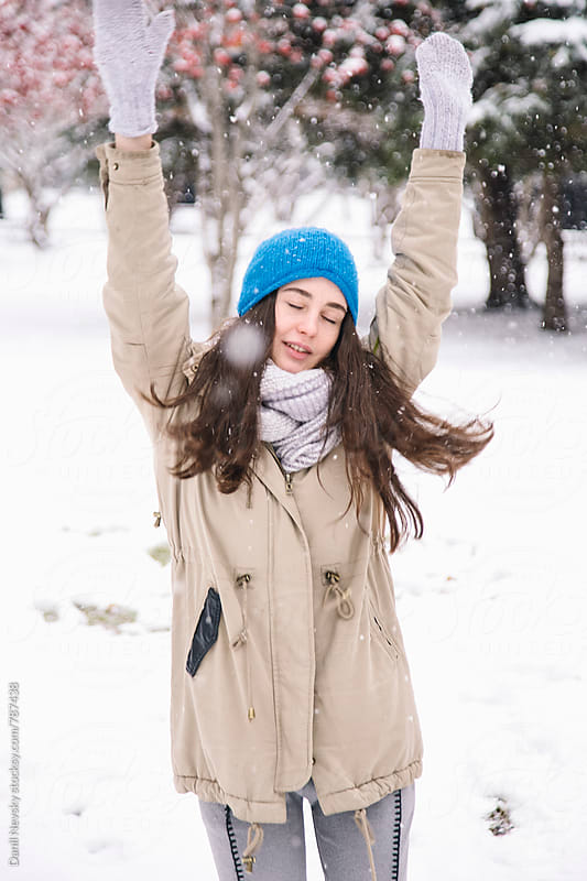 Cute young woman dancing with eyes closed outdoors by Danil Nevsky for Stocksy United