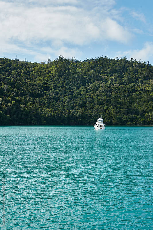Boat moors alone in the Whitsunday Islands by Joaquim Bel for Stocksy United