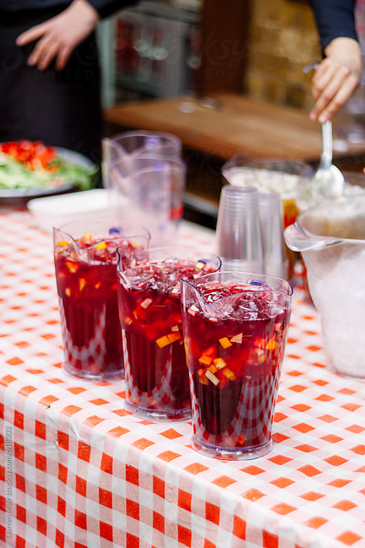 Jugs of sangria at a barbecue. by Darren Muir for Stocksy United