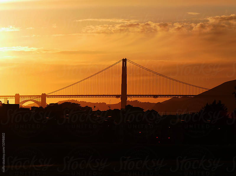 golden gate bridge at sunset by rolfo for Stocksy United