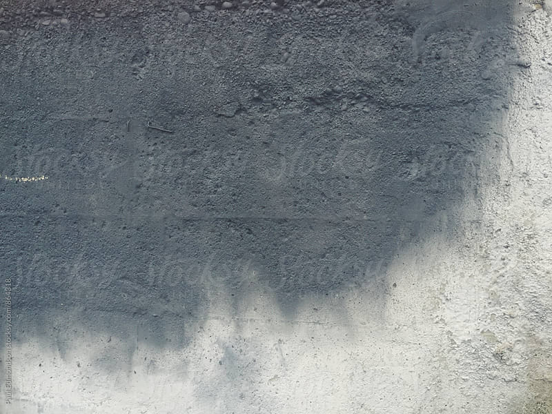 Grey paint covering graffiti tag on concrete wall, close up by Paul Edmondson for Stocksy United