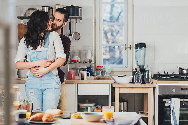 Hugged Couple in the Kitchen by Lumina for Stocksy United