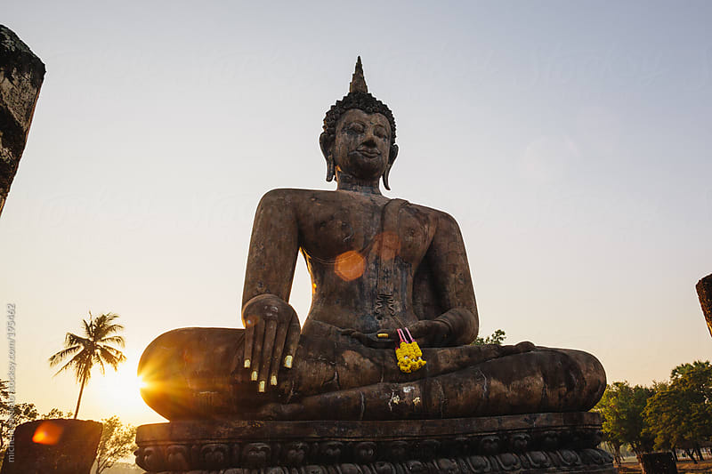 Buddha statue at sunset by michela ravasio for Stocksy United