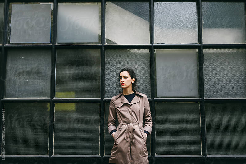 Young woman standing outdoor  by Marija Kovac for Stocksy United