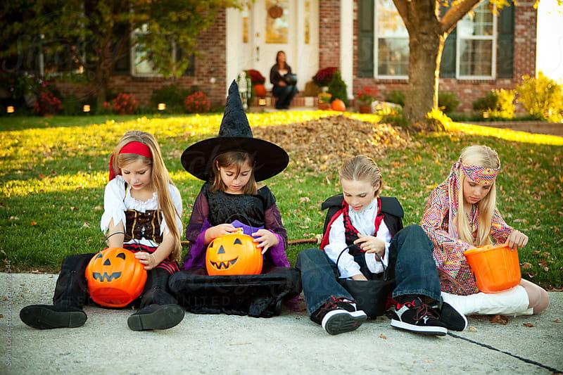 Halloween: Children Go Through Candy Buckets on Halloween by Sean Locke for Stocksy United
