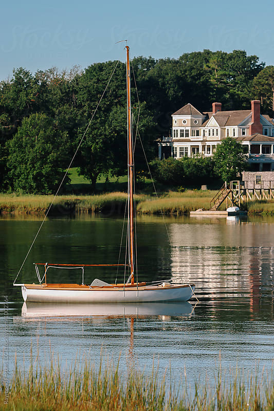 Wooden Boat in Harbor by Raymond Forbes LLC for Stocksy United