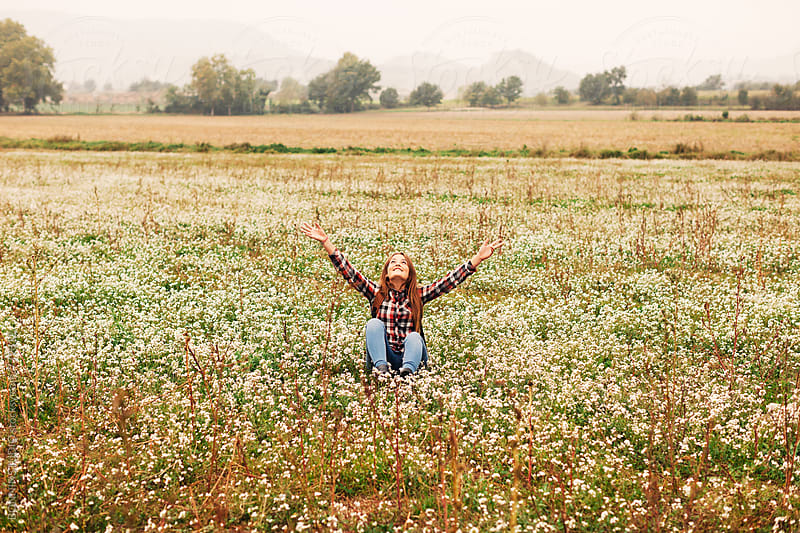 A 14 years old girl enjoying in a flowery field in autumn. by BONNINSTUDIO for Stocksy United