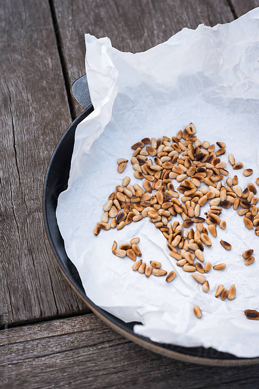 toasted pine nuts by Gillian Vann for Stocksy United