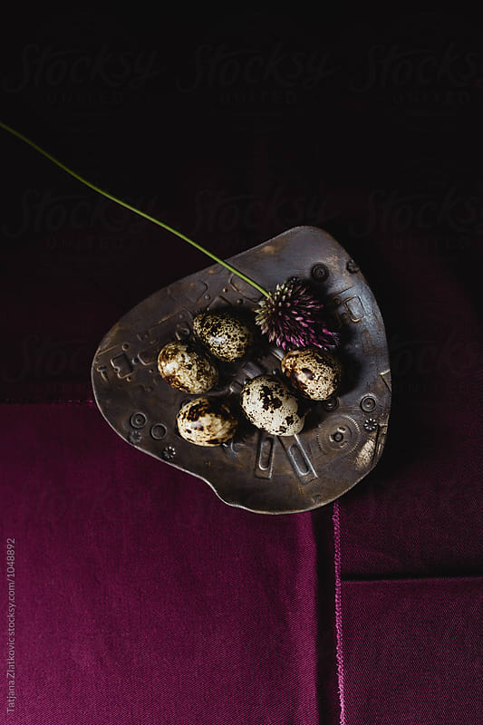 Quail eggs and flowers by Tatjana Ristanic for Stocksy United