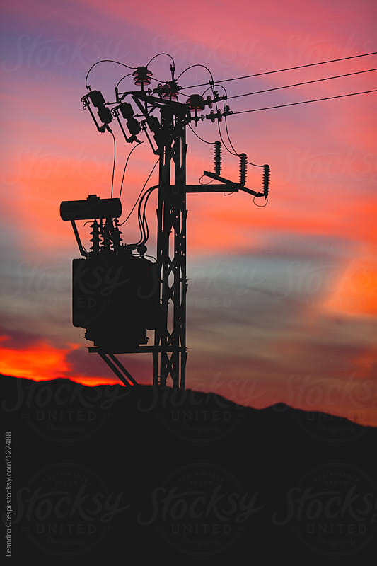 Electrical tower shoot in sunset by Leandro Crespi for Stocksy United
