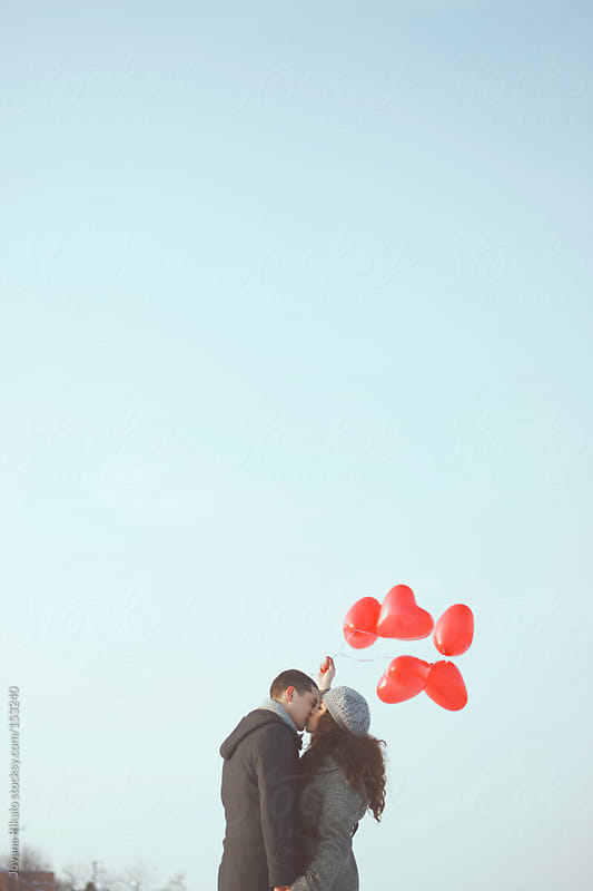 Cute young couple kissing by Jovana Rikalo for Stocksy United