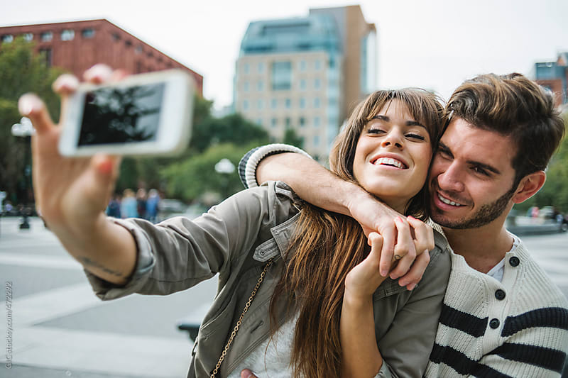 Happy couple taking a selfie in New York City by GIC for Stocksy United