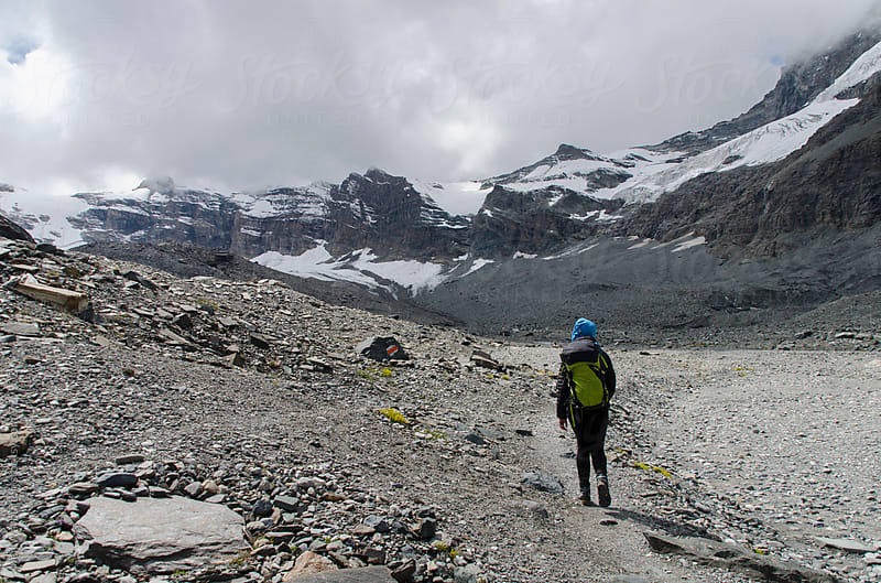 Hiking through Glacial terrain by Neil Warburton for Stocksy United