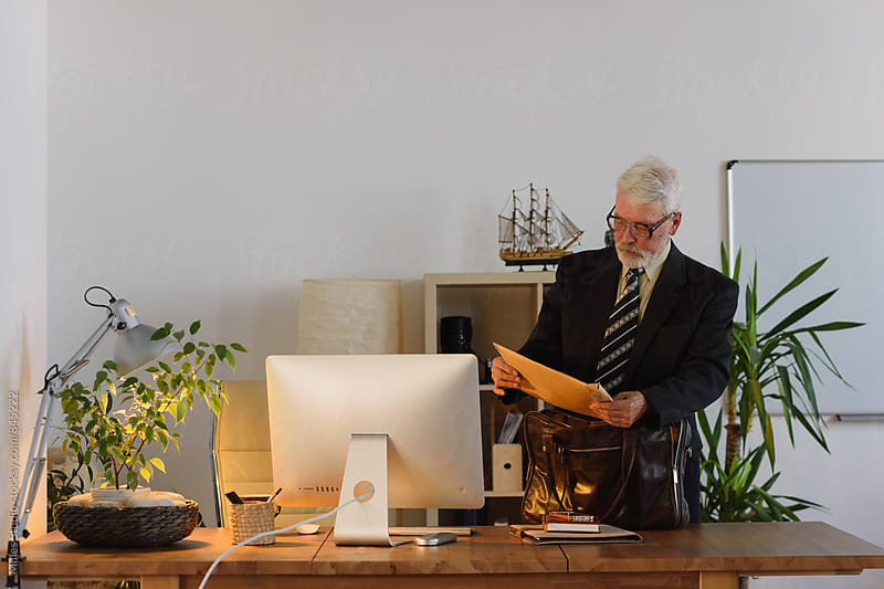 Businessman at Office by Milles Studio for Stocksy United