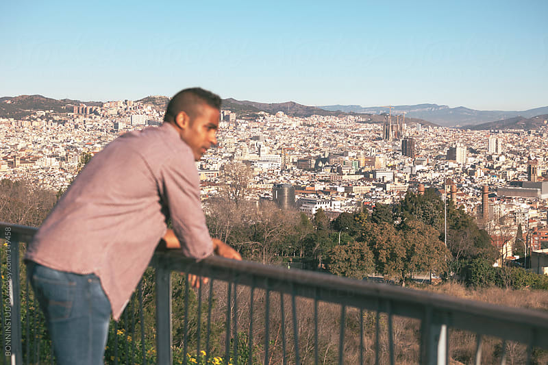 Black young man enjoying a nice panorama of Barcelona.  by BONNINSTUDIO for Stocksy United