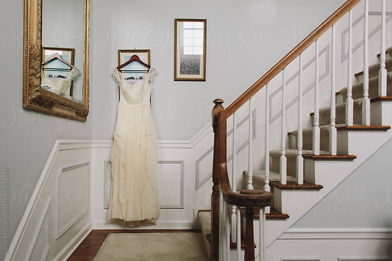 Wedding Dress Indoors by Sidney Morgan for Stocksy United