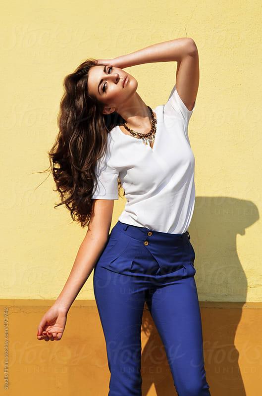 Stylish brunette enjoying the sun by Studio Firma for Stocksy United