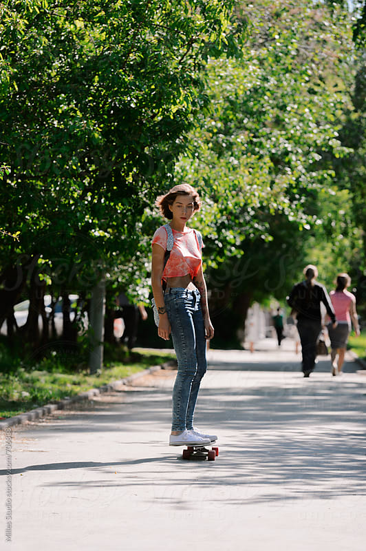 Girl on longboard by Milles Studio for Stocksy United