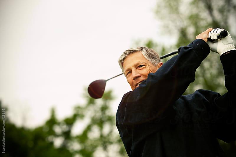 Golf: Senior Golfer After Swing by Sean Locke for Stocksy United