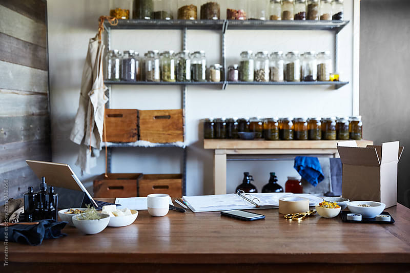 Desk at a skincare maker's studio by Trinette Reed for Stocksy United