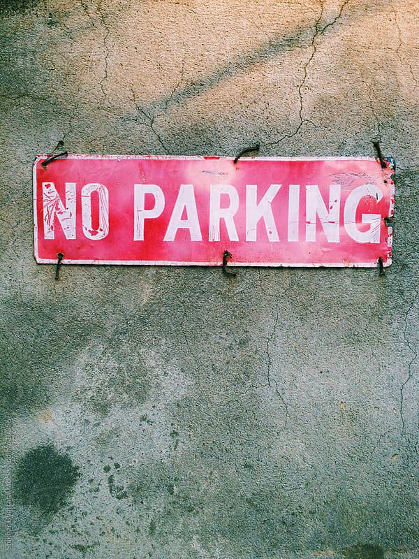 An old No Parking Signage. by Shikhar Bhattarai for Stocksy United