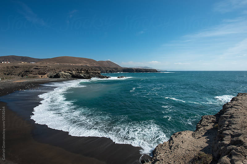 Black sanded beach of Ajuy in Fuerteventura by Gabriel Ozon for Stocksy United