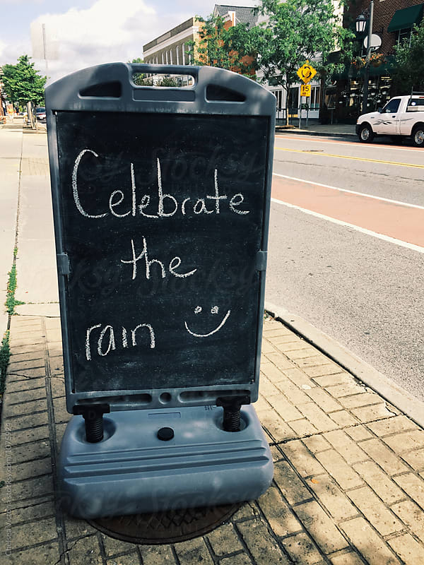 A sign that says celebrate the rain by Chelsea Victoria for Stocksy United