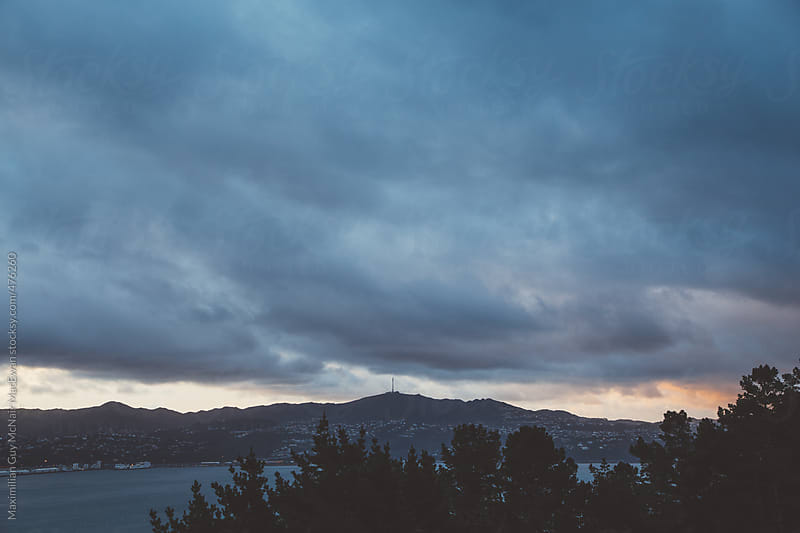 Sunset over the hills in New Zealand by Maximilian Guy McNair MacEwan for Stocksy United