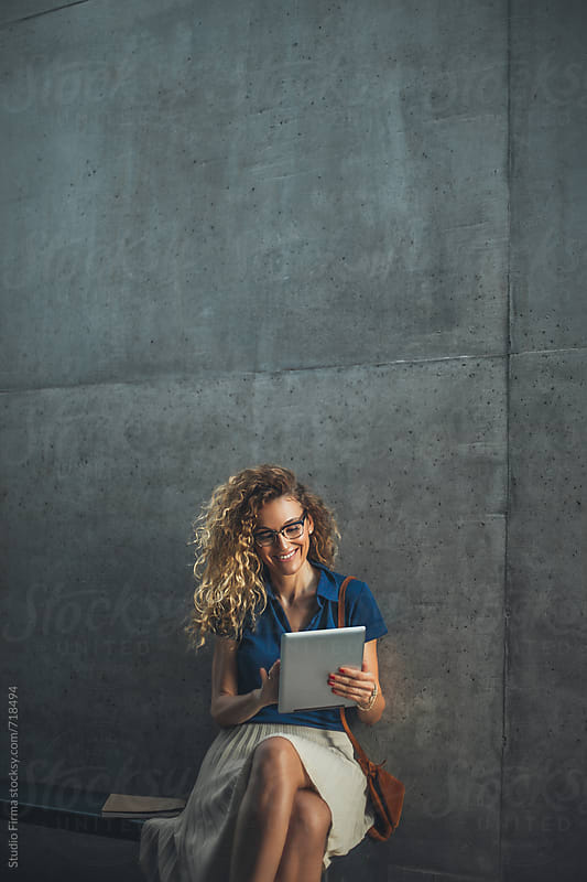 Businesswoman Pictured in a Hallway by Studio Firma for Stocksy United