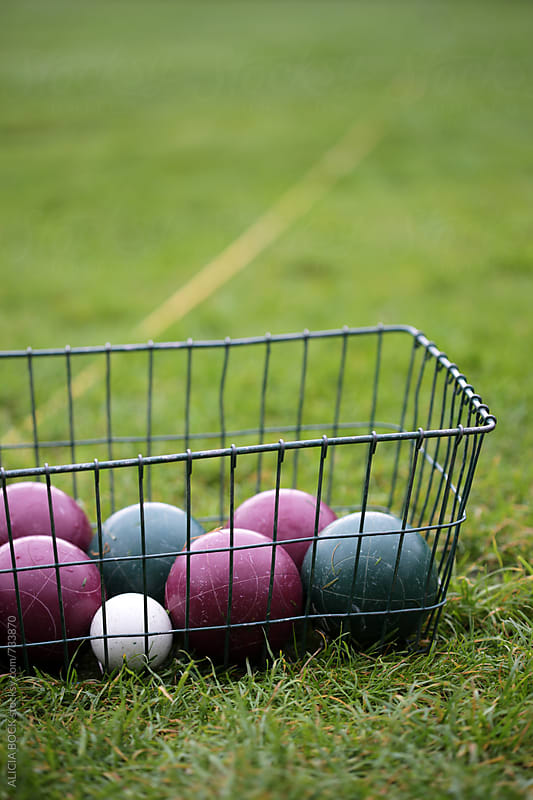 A Bocce Ball Set On A Grassy Lawn Ready For Play by ALICIA BOCK for Stocksy United