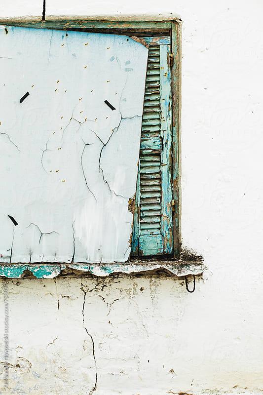 Detail shot of blue window of a greek house by Aleksandar Novoselski for Stocksy United