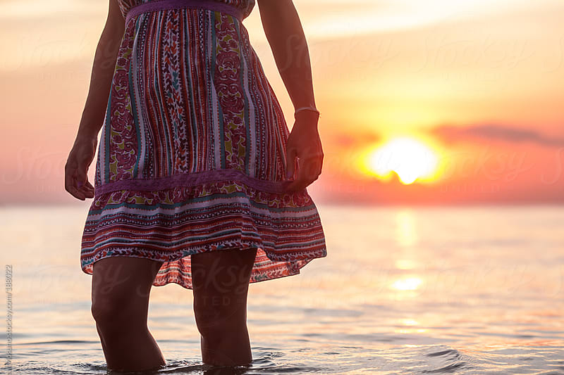 Anonymous Woman in a Colourful Dress at Sunset by Mosuno for Stocksy United