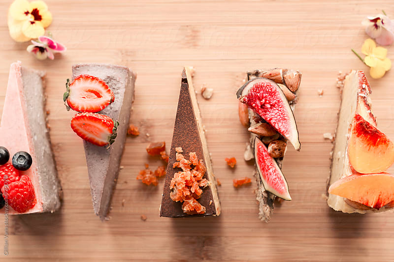 raw vegan dessert, cheesecakes slices by Gillian Vann for Stocksy United