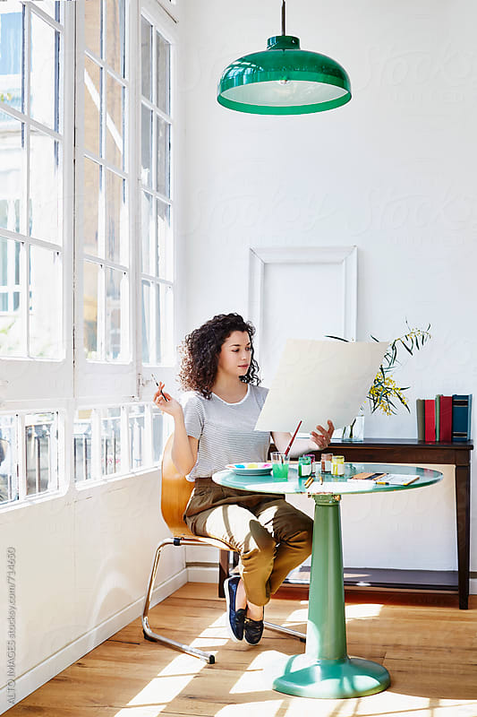 Woman Drawing At Table In House by ALTO IMAGES for Stocksy United