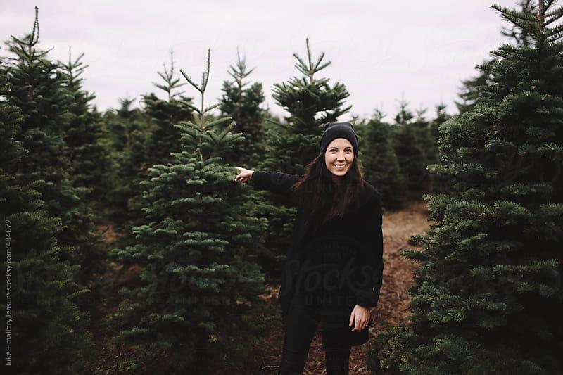 Girl in Tree Farm by luke + mallory leasure for Stocksy United