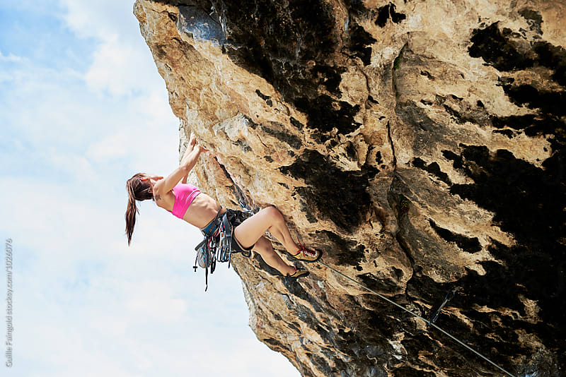 Female climber climbing the extreme cliff by Guille Faingold for Stocksy United
