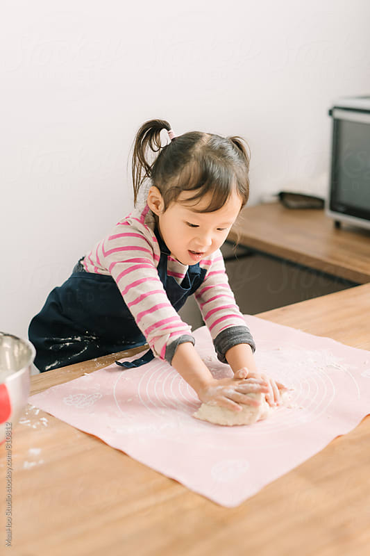 Toddler girl making dough by MaaHoo Studio for Stocksy United