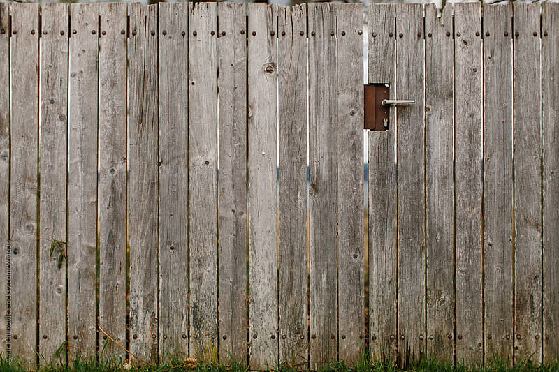 Wooden fence in countryside by Amir Kaljikovic for Stocksy United