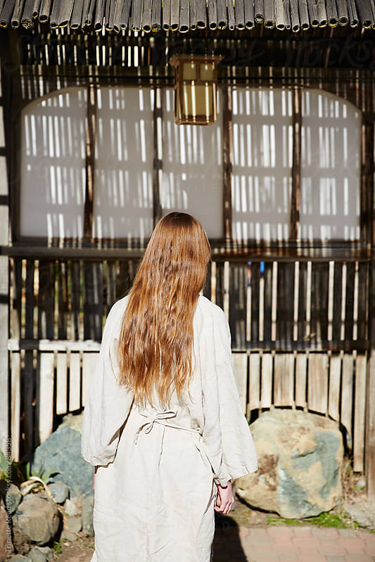 Woman walking into Japanese Hot Springs and Spa by Trinette Reed for Stocksy United