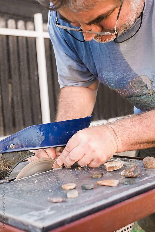 Senior Man Cutting Gemstones  by Mosuno for Stocksy United