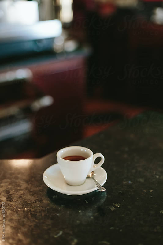 Tiny White Coffee Cup with Espresso Coffe in a Coffee Shop by HEX. for Stocksy United