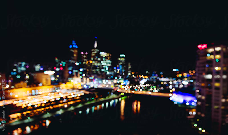 Melbourne central business district  at night by Angela Lumsden for Stocksy United