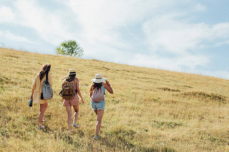Three Young Women Hiking Together by Lumina for Stocksy United