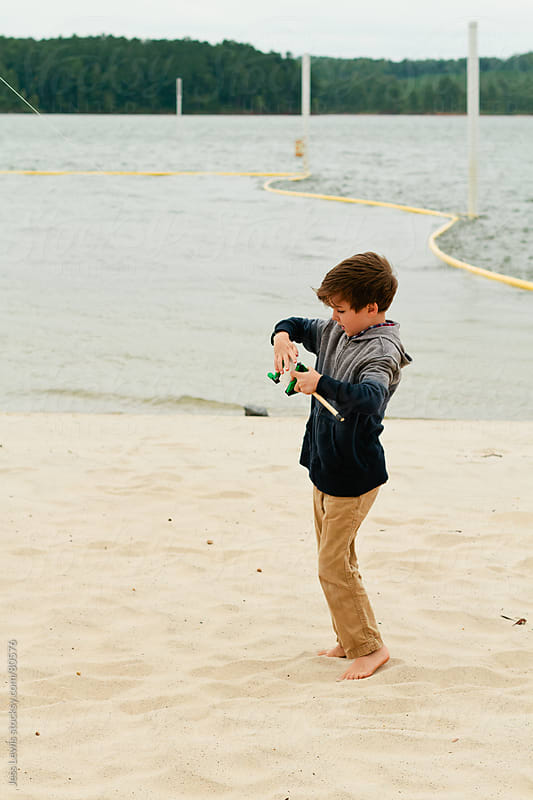 boy handling kite reel by Jess Lewis for Stocksy United