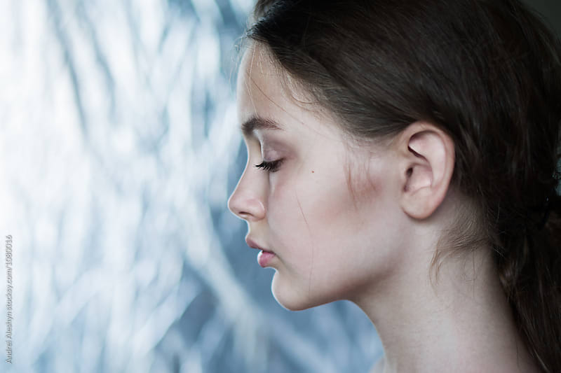 Profile of a beautiful young girl close-up by Andrei Aleshyn for Stocksy United