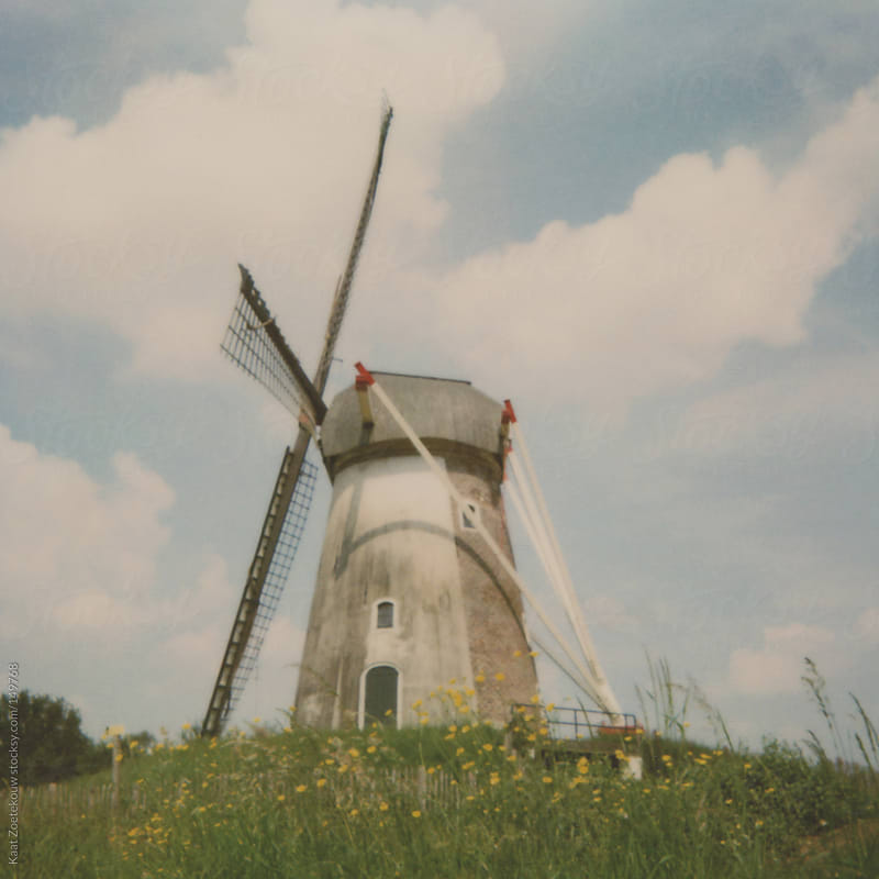 A frameless Polaroid of a windmill in a rural area of the Netherlands by Kaat Zoetekouw for Stocksy United